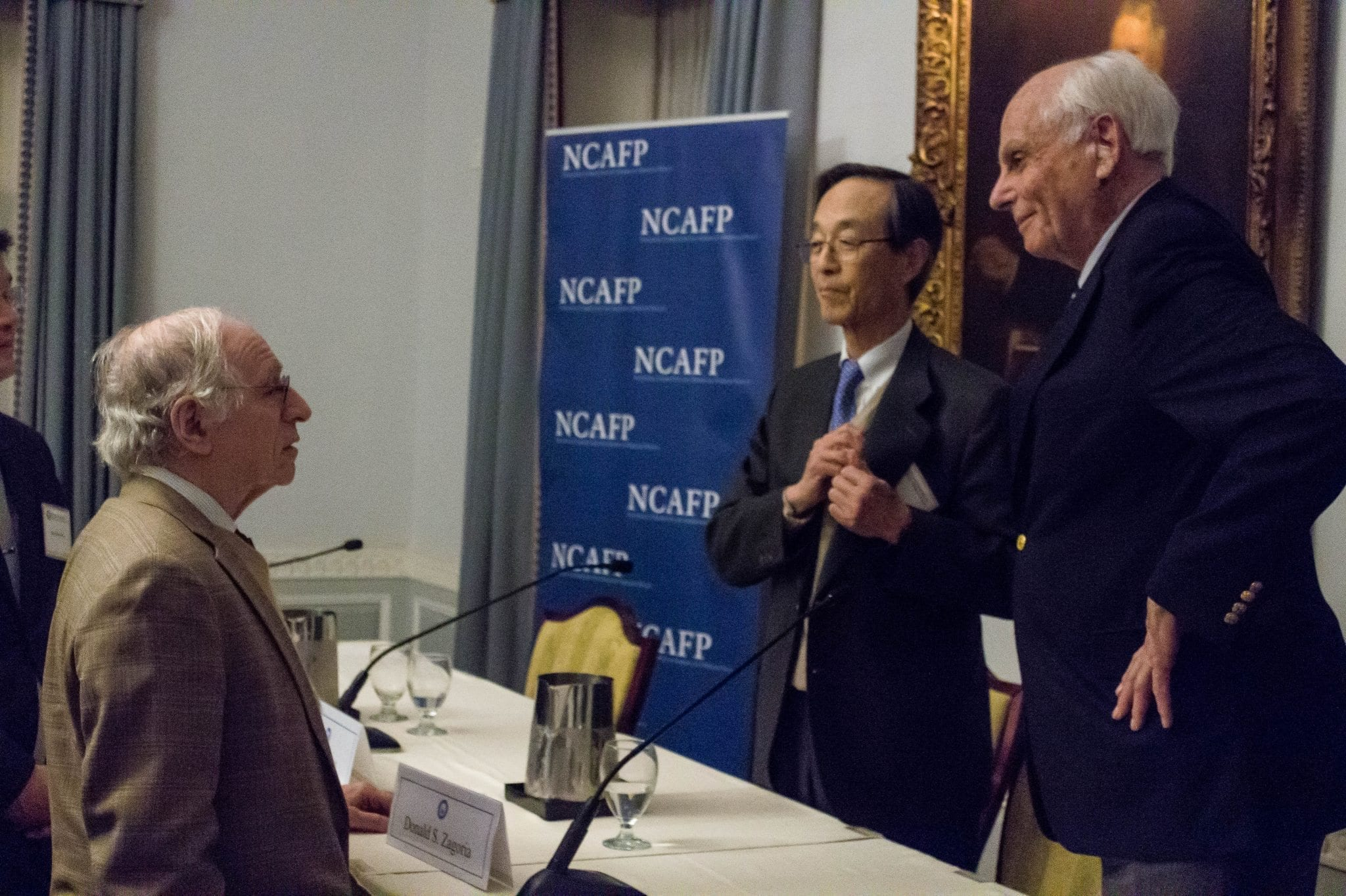 Professor Gerald Curtis engages with Minister Han and Dr. Zagoria after the program